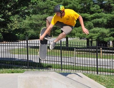 Skate park instructor doing a trick