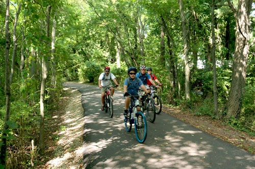 People biking on Huckleberry Trail