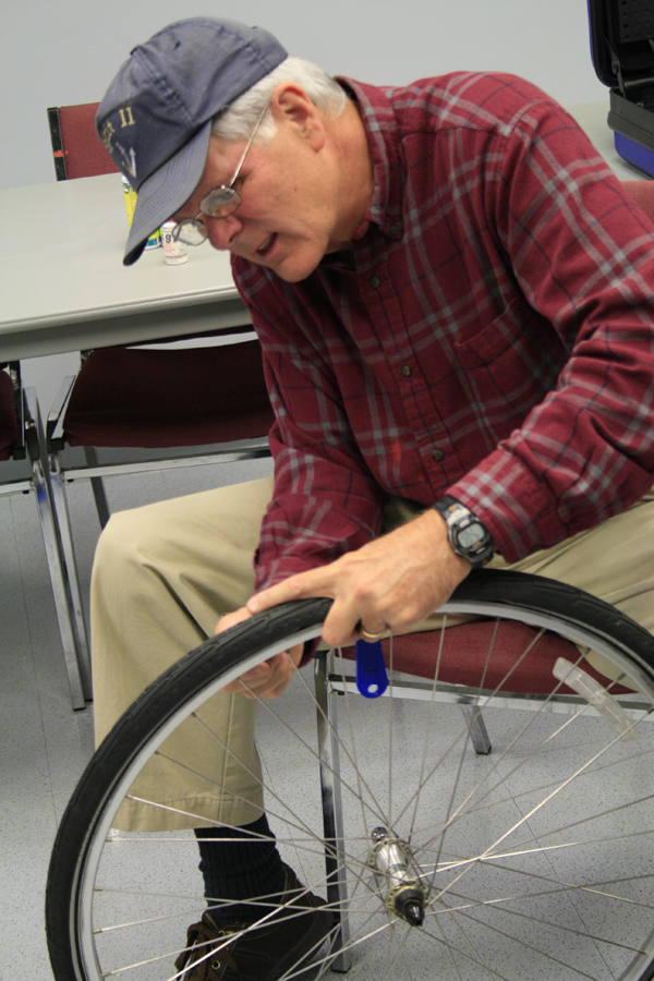 older adult working on a bike