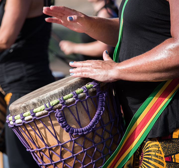 Close up of drum as man plays