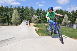 Biker and skater at the Skate Park